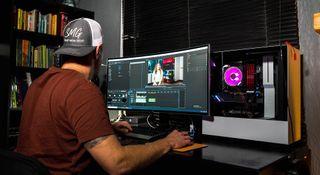 man editing video on a pc