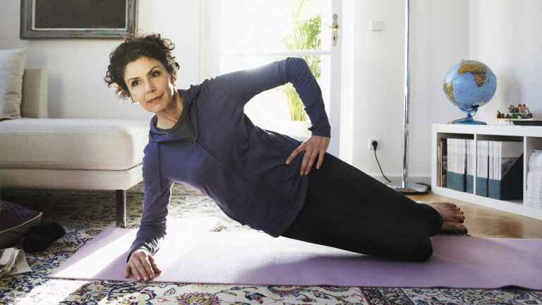 Woman practicing yoga over 50