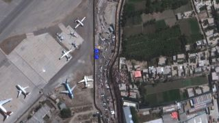 Crowds converge near Abbey Gate at Hamid Karzai International Airport in Kabul, Afghanistan, in this satellite image taken on Aug. 24, 2021.