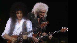 Brian May appearing onstage with Brian May