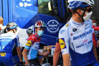 Bob Jungels wears a face mask before the training ride rolls out