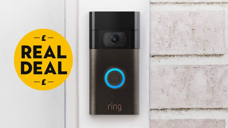 All-new Ring Doorbell on white brick wall with Real Deal badge