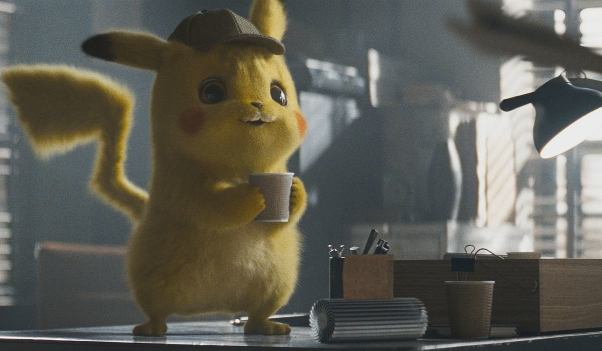 Pokemon: Detective Pikachu Pikachu drinks a coffee on his desk