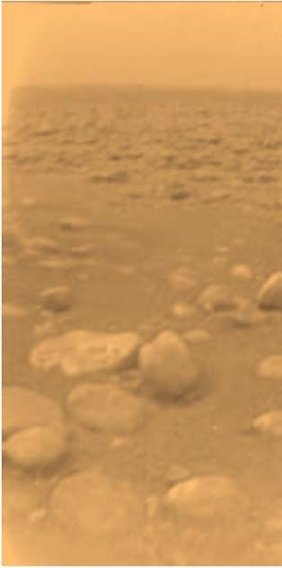 The Huygens probe took this photo from the surface of Titan. The image has been colored and processed to give a good indication of the actual orangeish color of the surface.