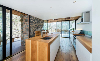 wooden worktops exposed stone wall kitchen