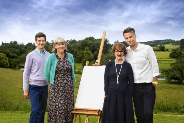 The Big Painting Challenge judges pose with an easel