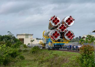 An Arianespace Soyuz rocket rolls out to the launch pad at the Guiana Space Center in French Guiana for the VS23 mission, on Dec. 12, 2019.