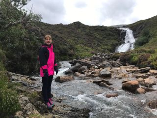 Darcey Bussell stands by a Scottish river