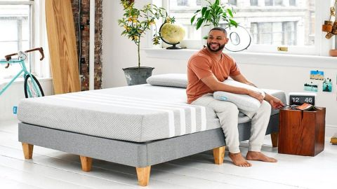 Leesa Original Mattress in a bedroom with a man sitting on the side