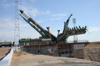 The unmanned Russian supply ship Progress 48 is raised into launch position ahead of its Aug. 1, 2012 EDT launch