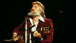 Kenny Rogers performing on stage