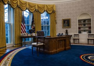 A view of the Resolute desk seen during an early preview of the redesigned Oval Office awaiting President Joseph Biden at the White House in Washington, D.C. on Jan. 2021. An Apollo 17 moon rock can be seen on the bottom shelf of the bookcase at far right.