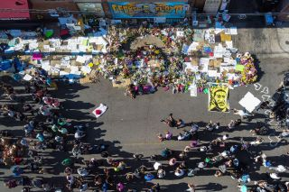 An aerial view shows people gathering to pay tribute at a makeshift memorial in honor of George Floyd, on June 3, 2020 in Minneapolis, Minnesota.