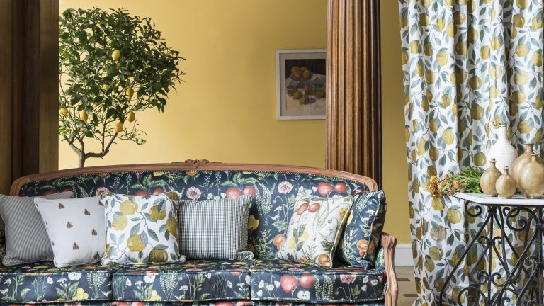 Fruit motif printed sofa and curtains in a country home