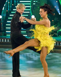 Christine donned a canary-yellow dress to jive to an Elvis classic
