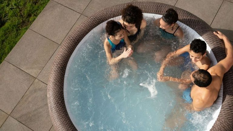 Best hot tubs 2021 - a birds eye view of a family in a hot tub