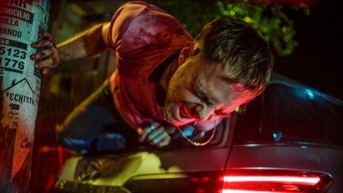 Ciro (Peter Lanzani) crawling from the wreckage in '4x4'.