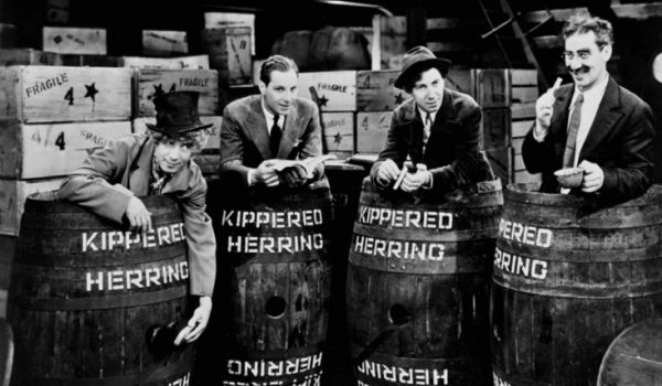 The Marx Brothers in barrels in Monkey Business