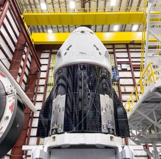 SpaceX's first Crew Dragon spacecraft for the Demo-2 test fight with astronauts is seen before being mated to its Falcon 9 rocket.