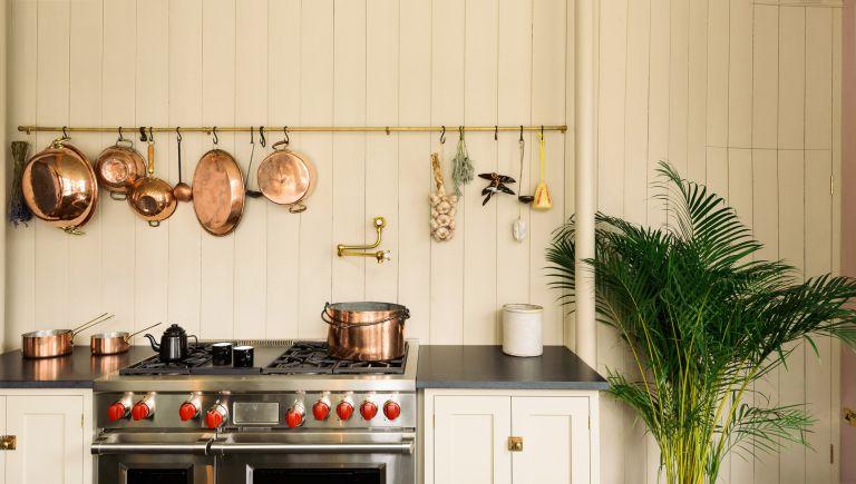 Pot filler trend in a cream colored kitchen