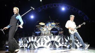 David Lee Roth, Alex Van Halen and Eddie Van Halen of Van Halen perform at Concord Pavilion on July 9, 2015 in Concord, California