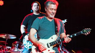 Bassist Wolfgang and Guitarist Eddie Van Halen of Van Halen perform at Perfect Vodka Amphitheatre in West Palm Beach, FL