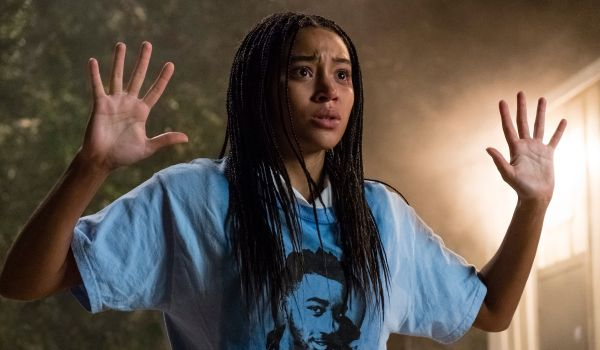 Amandla Stenberg holding her hands up in The Hate U Give