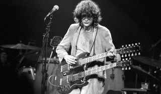 Jimmy Page plays his Gibson EDS-1275 at a benefit for Ronnie Lane's charity, ARMS, in 1983