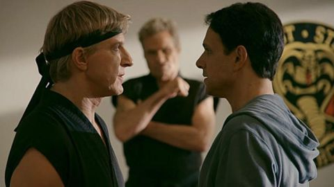 Johnny Lawrence (William Zabka) and Daniel LaRusso (Ralph Macchio) come face to face while Kreese (Martin Kove) waits for them to fight.
