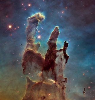 "Hubble Space Telescope view of the ""Pillars of Creation,"" towering formations of cosmic gas and dust that lie in the center of the Eagle Nebula."