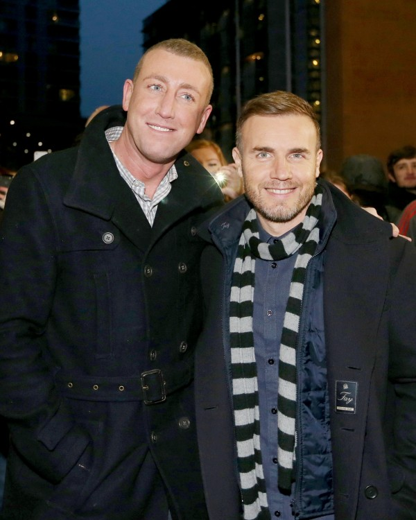 X Factor finalist Christopher Maloney with Gary Barlow in 2012