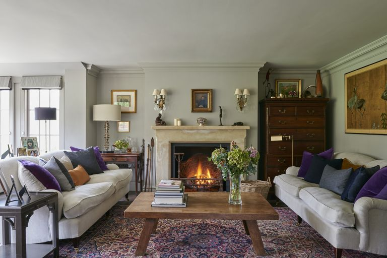 Living room with cream sofas and fireplace