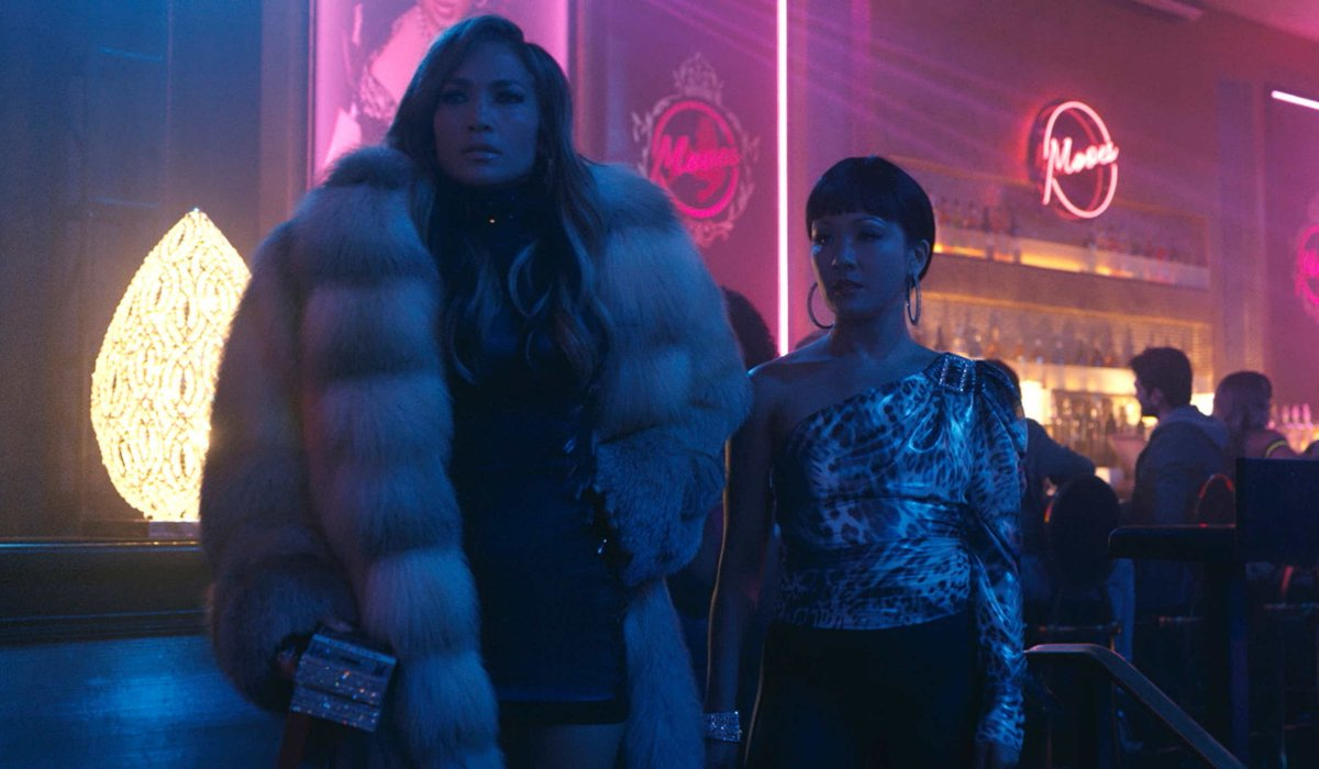 Hustlers Jennifer Lopez and Constance Wu scheming in the club