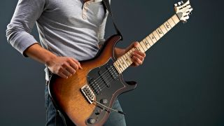 Guitar player with a PRS Brent Mason Signature electric guitar