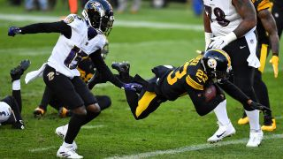 Joe Haden #23 of the Pittsburgh Steelers carries the ball for a touchdown after intercepting a pass during the first quarter against the Baltimore Ravens at Heinz Field on Dec. 1, 2020 in Pittsburgh, Pennsylvania.