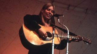 Joni Mitchell performs at the Central Park Music Festival in New York, New York in 1969