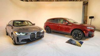 The BMW i4 sedan and BMW iX in a showroom