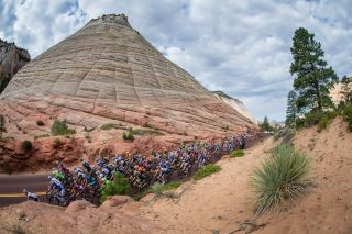 The Tour of Utah peloton passes by Checkerboard Rock in Zion National Park.