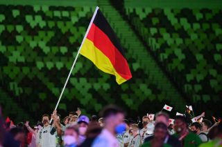 Germanys flag bearer Patrick Hausding L leads the delegation as they parade during the opening ceremony of the Tokyo 2020 Olympic Games at the Olympic Stadium in Tokyo on July 23 2021 Photo by Andrej ISAKOVIC AFP Photo by ANDREJ ISAKOVICAFP via Getty Images