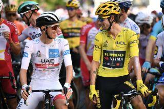 UAE Team Emirates' Tadej Pogacar (left) chats with Slovenian compatriot and 2020 Tour de France leader Primoz Roglic (Jumbo-Visma) ahead of the start of stage 14