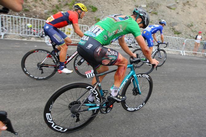 Peter Sagan remounts his bike following his stage 17 crash at the Tour de France