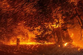 Wind and flames rip through an area near Geyserville, California, during the Kincade Fire on Oct. 24, 2019.