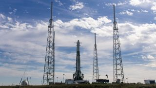 A SpaceX Falcon 9 rocket stands ready for launch at Cape Canaveral Air Force Station in Florida.