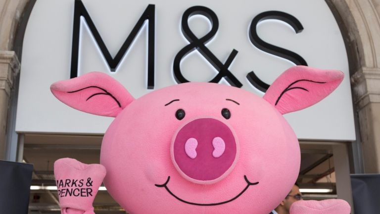 M&S launch giant Percy Pig eggs: A Percy Pig mascot helps to advertise the new Marks & Spencer store on the concourse of Waterloo Statio
