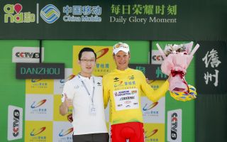 Fausto Masnada pulls on the yellow jersey as overall winner of the 2018 Tour of Hainan