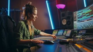 a woman using a music mixing desk