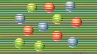 12 spheres sit on a field of green, red and blue stripes, with some stripes crossing in front of the spheres