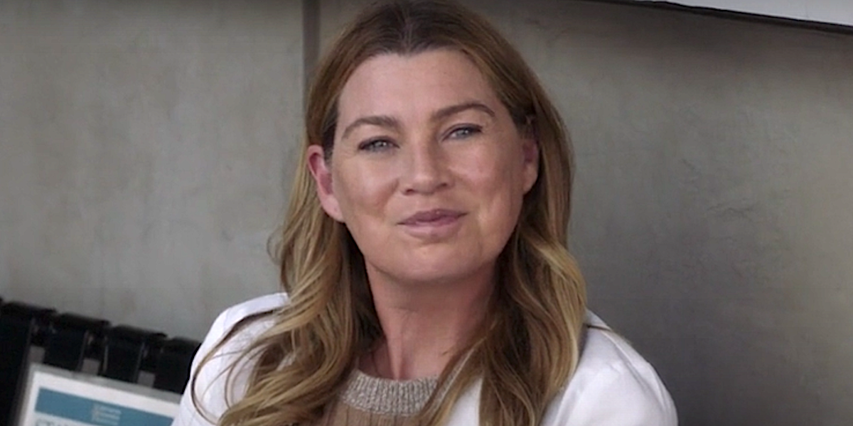 Grey's Anatomy Meredith Gray sits on a bench.