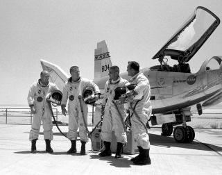 HL-10 pilots (left to right) Air Force Major Jerauld R. Gentry, Air Force test pilot Peter Hoag, and NASA pilots John A. Manke and Bill Dana. The HL-10 was one of five lifting body designs flown at NASA's Dryden Flight Research Center, Edwards, California
