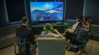 Attendees to an early access event play on an Xbox console racing game at the new Microsoft Corp. flagship store in central in London, U.K., on Tuesday, July 9, 2019.